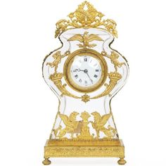 """FRENCH EMPIRE ORMOLU MOUNTED GLASS MANTEL CLOCK, Circa Early 19th Century, Movement impressed """"€œS.F.""""€, ex. Walters Art Museum loan label verso<BR><BR>Item # 602UPG06<BR><BR> A rare and very fine Empire mantel clock, this precise timepiece is a truly magnificent object d""""€™art from the first half of the 19th century. The gilt work is absolutely gorgeous, particularly noting how tiny each embellishment is - the finely tooled bronze reflects the patience and skill of the founder. The…"""