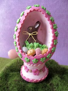 Easter egg chocolate bunny diorama made with polymer clay.  Designed and created by Lianne and Paul Stoddard of Swirly Designs.