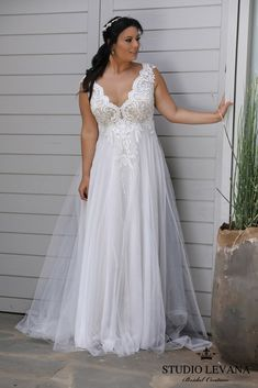 Romantic flattering plus size wedding gown with unique lace bodice. Tracie. Studio Levana