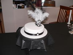 Flapper style cake - style cake inspired by the Flapper girls theme of the birthday party. butter cake covered in white RTR, black and white RTR used for flowers, centers have pearls made with fondent covered in pearl dust. Flapper Style, Flapper Girls, 1920s Style, 20th Birthday, Birthday Parties, Birthday Ideas, 1920s Cake, 1920s Party, Girl Themes