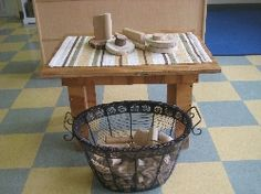 Children need different levels to build on. Try adding a small table to the block center, and see what they create! I love the ornate basket.
