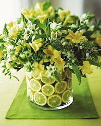 I'm creating centerpieces for my friend's wedding. All it is are clear vases with a flower arrangement. How can I dress up the vase so you don't s Fruit Centerpieces, Wedding Centerpieces, Wedding Decorations, Centrepieces, Lime Centerpiece, Diy Wedding, Wedding Flowers, Diy Flowers, Lemon Flowers