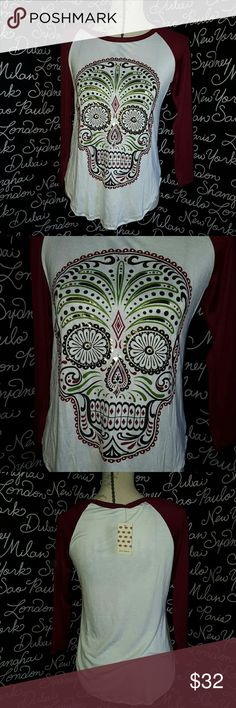 NWT Cutest sugar skull baseball T This is a ❤new with tags❤ white and burgundy baseball t shirt, long sleeve with a multi colored sugar skull on the front with some Metallica colors. This is a stretchy material and is very soft.  Please ask any and all questions before purchasing this item Boutique Tops Tees - Long Sleeve