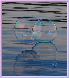 """My bubble within a bubble"" from http://designbeep.com/2011/02/17/35-stunning-examples-of-soap-bubble-photography/ So elegant."