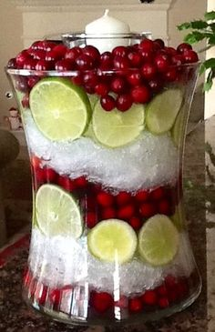 Cut limes, Cranberries and Saran Wrap!!! Fill hurricane with water and Saran Wrap looks like crushed ice!!!  Via Instagram debmildenstein