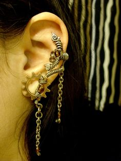 @Patricia Doiron, Steampunk. Amber Alchemist Ear Cuff.  Thought you might like this.