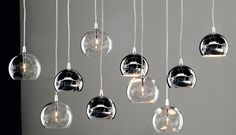 Stunning ceiling light with a Clear glass sphere set beneath another sphere of either Clear, Copper, Bronze or Chrome Glass. Available as a single drop or in clusters of five or eight. Ceiling fixings are in Chrome.