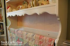 repurposed desk hutch into shelves with quilt rack:  Becky Schultea at Just Bee 'n Me