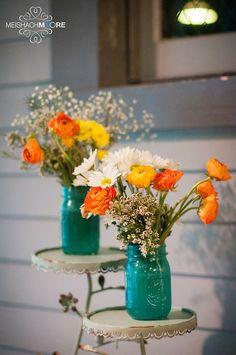 Mason jars painted turquoise and these adorable ranunculus flowers are the perfect whimsey for a wedding ♥