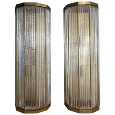 Large Pair of Italian Glass and Brass Wall Lights   From a unique collection of antique and modern Wall Lights and Sconces at https://www.1stdibs.com/furniture/lighting/sconces-wall-lights/.