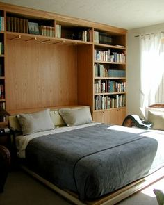 King sized murphy bed with wall to wall storage.