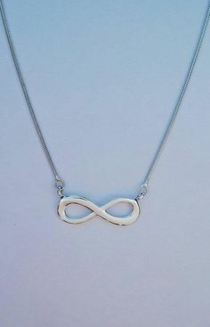 The infinity symbol has been popular since we can remember! This horizontal infinity pendant is fixed on a sterling silver snake chain which gives it that extra classy look. Infinity Pendant, Infinity Necklace, Infinity Symbol, How To Look Classy, My Etsy Shop, Jewels, Sterling Silver, Chain, Jewellery