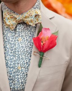 Crepe-paper blooms for the guys' lapels, attaching each to their suit jackets with oversized bronze safety pins.