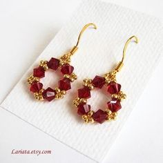 siam red and gold earrings | Flickr - Photo Sharing! I think I can figure out how to make something similar.