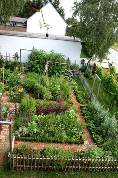 "Potager Garden Garden with brick ""floor"" More - Kitchen gardens are truly an art ! And this one in Austria is particularly well designed ! The traditional kitchen garden is also known as a potager."