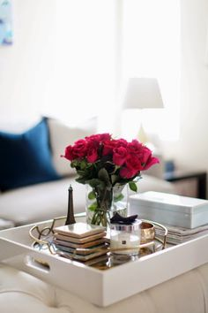Elegant tray styling. Ottoman coffee table vignette