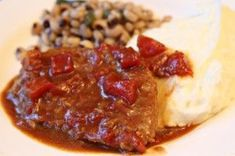 swiss steak with tomato gravy - convert recipe for crock pot A few weeks back, I asked you all if there was something that y'all wanted to see on Southern Bite. I was flooded with responses, which was incredible. One request was for Swiss Steak. Swiss Steak Recipes, Cube Steak Recipes, Pork Recipes, Crockpot Recipes, Cooking Recipes, Kale Recipes, Slow Cooking, Cooking Tips, Amigurumi