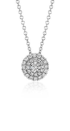 Bold and beautiful, this diamond pendant is surrounded by a shimmering double halo of round pave-set diamonds framed in 18k white gold.