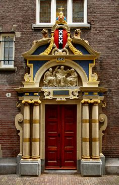 Door in Amsterdam Spinhuispoortje by Panticore, via Flickr. The crest with the three x's is the symbol of the city of Amsterdam.