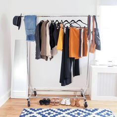 How I Chose My Capsule Pieces: I started with three pieces I am currently excited to wear (straight-leg jeans, striped skirt, and orange tank) and moved them to a custom category in Stylebook. Next, I began adding pieces I had a feeling would pair well with them based on color. My goal was to make sure every top matched every bottom. Initially, I had way more than ten items, but I edited them down by creating a few test outfits. If I couldn't make multiple outfits with an item, I eliminated it. Capsule Wardrobe, Wardrobe Rack, Minimalist Closet, Multiple Outfits, Minimal Wardrobe, Co Founder, Stripe Skirt, Wardrobes, Spring