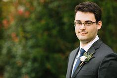 Groom in dark grey suit with white ranunculus boutonniere 10.28.17 :: Rachel + Joe | Cedarwood Weddings