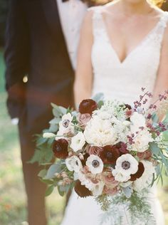 This bouquet of anemones, ranunculuses, garden roses, Queen Anne's lace, dusty miller and seeded eucalyptus balances contrast and texture for a winter wedding. {Shandi Wallace Photography}
