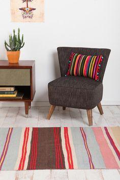 I like the chair - pillow - rug combo.