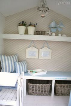 Lykkobo playhouse.  add baskets under bench for toys and pillows to the bench artwork and shelves.