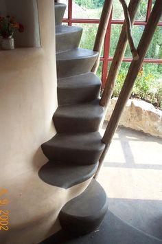 Cob stairway~Designed by Fresh Peek House. Cob is an ancient building technique that uses clay, sand, and straw mixed with water to create an adobe-like material.    http://freshpeekhouse.com