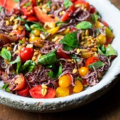 Tomatoes with sumac onions and pine nuts