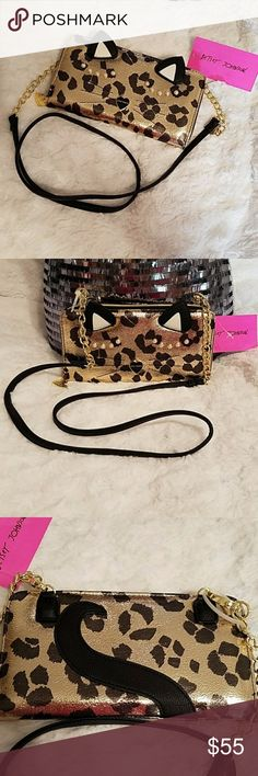 "🎉LAST CHANCE!🎉NWT-BETSEY JOHNSON CHEETAH WALLET 🛑FINAL PRICE DROP- LAST CHANCE🎁 🌹NWT- BETSEY JOHNSON CHEETAH WALLET ON A STRING! Such a great bag just love the design the outside is so much fun this bag offers detachable cross-body strap, zipper closure at wallet compartment and zipper at coin pouch. The exterior has several awesome designs Interior has 8 wallet card slots & 2 more slots plenty of room for all your things MEASUREMENTS: W9"" X D1"" X H5 1⁄2"" 🌹NWT- BRAND NEW WITH TAGS…"