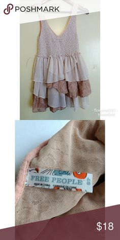 Free People Ruffel Tank Used condition Beautiful nude color In great condition Please see pictures Free People Tops Tank Tops