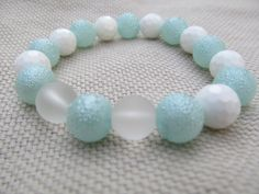 White faceted shell light aqua bumpy glass pearl by littlecrowshop, $17.00