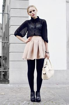 Tulip skirt, sheer top, tights and booties