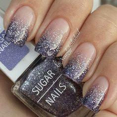 Gradient nail art and silver glitter nail art designed in French tips. Stand out of the crowd with beautiful glitter nail art inspired designs