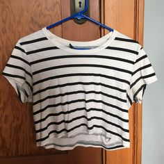 Stripped crop top Good condition, only issue is tag is falling off, but you can take off completely. Just simple black and white crop top. Comes to belly button Urban Outfitters Tops Crop Tops