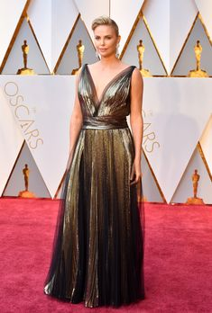 Charlize Theron in Christian Dior Couture and Chopard jewelry