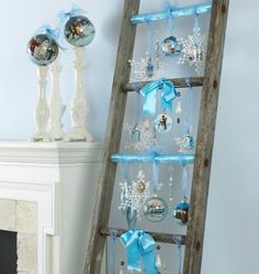 Create an unusual holiday display by hanging ornaments from a vintage ladder. Click to see other ways to use those extra Christmas ornaments.
