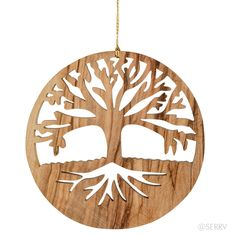 Tree Of Life Ornament  Artisans in Bethlehem source olive wood from the Holy Land to create these carved ornaments, beautiful silhouettes against you tree, window, or wall. #fairtrade www.serrv.org