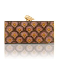 The Empire Levin features Japanese Art Deco inspired floral panels in Rose, created by hand using the ancient cloisonne technique of fine bronze wire and enamelling originally displayed in Byzantine jewelery and Chinese porcelain. The panels are set in a gold-plated brass frame, with signature KOTUR brocade lining and faceted closure, and a 30 cm drop in chain. It fits your evening essentials, and a smartphone (up to an iPhone 6+)