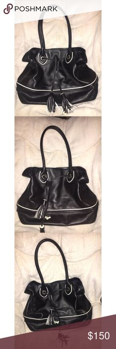 🖤 AMAZING Black Cole Haan Purse EUC! 🖤 This is an amazing, medium/large size black Cole Haan handbag / purse. EUC. Only used a handful of times for interviews. I love the tassel tie on this bag. Gold hardware.  Tote bag style straps make this bag really easy to carry. Cole Haan Bags Shoulder Bags