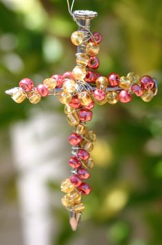 These beaded crosses are quick and easy to make - simple enough for children to make as home-made gifts Christmas craft children kids preschoolers beads beaded cross nails art advent kindergarten Jesus Christ centred centered activities Christian church wire hand-made home-made handmade homemade cheap easy simple present gift family Father Mother Grandparent take-home favour favor baptism faith belief believe dedication bookmark decoration tree wrapping table setting ornament decorating