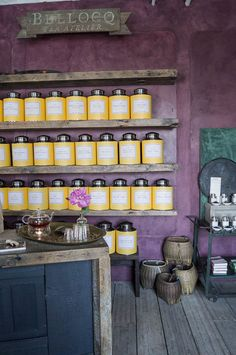 Bellocq Tea Atelier x The Shopkeepers The aubergine wall color came first, which informed the iconic yellow, navy and silver plated tea caddies.  Read more http://theshopkeepers.com/shopkeeper/bellocq.html