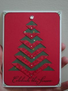 handmade Christmas card ... clean and simple ... cut and folded down branches on Christmas tree ... red top panel reveals green background below ... like that the back of the red paper is patterned and shows off the folding ... like this card!!