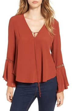 Free shipping and returns on ASTR Crochet Trim Bell Sleeve Top at Nordstrom.com. Sheer crochet insets trace the billowing bell-shaped sleeves that add '70s-inspired style to this breezy V-neck blouse.