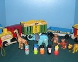 """Vintage Fisher Price toys from the late 1960's-early 1990's including play sets, little people, accessories, Pick Up 'N Peek puzzles, Fun with Food items, My Friend Dolls and clothing, and other """"dramatic play sets""""."""