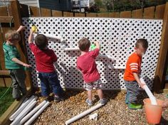 water wall - this is elastic threaded up and down fence which pipes are slipped into. Very flexible for kids to move around. Must try this!