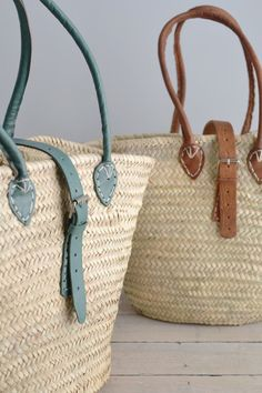 Classic French market bags handwoven from palm leaves. Sage green leather handles and buckle. Supports a fair trade artisan group in Morocco. UK FREE DELIVERY.