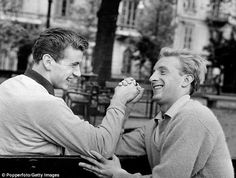 Denis Law (right) arm wrestles with his Torino team-mate Baker in February 1962