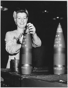 A woman builds shells at the Cornhusker Ordnance Plant in Grand Island, NE, during #WWII. NARA photo.